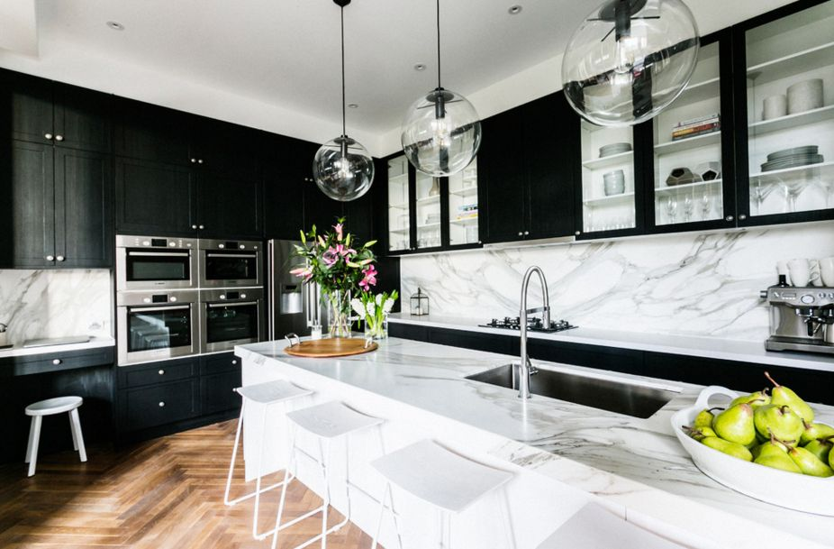 White marble and black kitchen cupboards