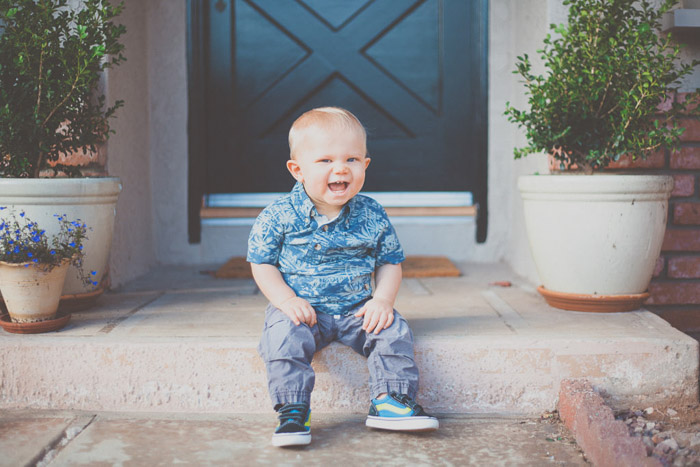 A baby boy sitting on an outdoor step - children photography